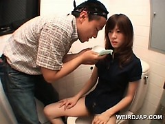 asian-teen-cutie-shows-twat-while-pissing-in-a-toilet
