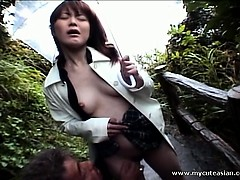 lovely asian girl gets finger nailed outdoors