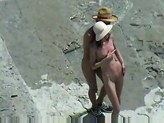 couple-fucks-on-nude-beach