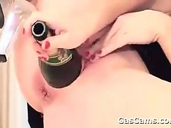 milf-masturbates-with-bottles