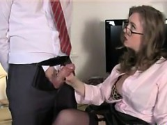 milf-giving-a-handjob-at-the-office