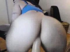 cute-woman-with-big-ass-riding-dildo