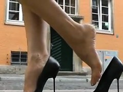 woman-in-a-red-dress-walking-around-in-heels