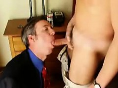 fully-clothed-businessman-sucks-toyboy