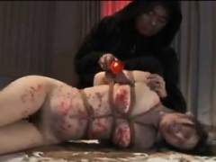 Bound Asian Milf Gets Candle Wax On Her