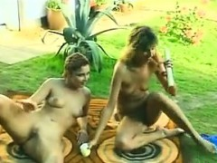 lesbian-lovers-outdoors-with-their-toys