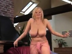 busty-blonde-chick-dancing-and-stripping