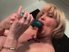 chesty-mature-gets-fingered-and-rides-dildo