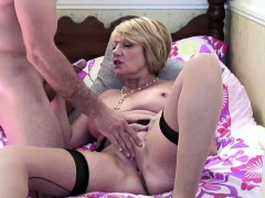 lusty-busty-mature-fucks-a-young-stud