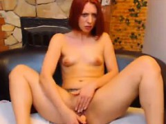 horny-redhead-strips-and-uses-her-toy