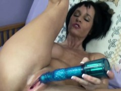 mature-brunette-melissa-swallows-plays-with-two-dildos