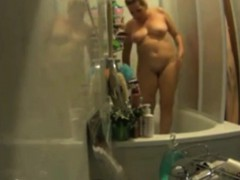 my-busty-mother-showering-in-the-evening