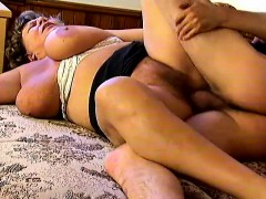 huge-breasted-granny-naomi-loves-to-work-her-hairy-slit-on-a-hard-cock