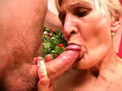 horny blonde granny takes her dentures out and blows a prick