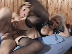 slutty mature girl in black stockings gets banged deep by a young guy