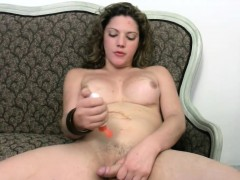 striking-shemale-with-curly-hair-strokes-her-thick-shemeat