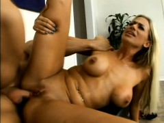 striking blonde with huge hooters welcomes a long pole up her needy ass