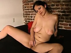 evie-loves-playing-with-her-large-tits-and-as-she-sits