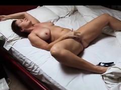 mature-on-bed-masturbating-having-orgasm