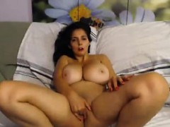 brunette-with-huge-natural-tits-masturbates-on-the-sofa