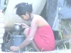 indian teen washing outdoors