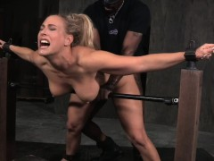 restrained-sub-with-big-tits-gets-spitroasted