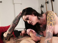 inked-goth-milf-blows-cock-before-riding-it