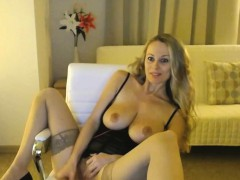 blonde-milf-in-dark-lingerie-masturbating