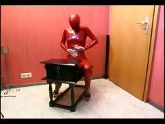 tied-up-slave-girl-posing-in-latex