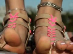 wearing-sandals-on-her-beautiful-feet-outside
