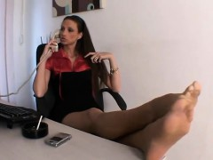 smoking-and-showing-off-her-feet-in-an-office