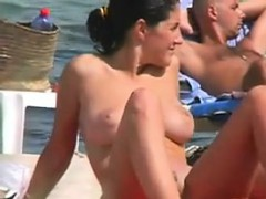 Tanning And Smoking Outdoors At The Beach