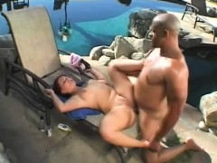 Busty Redhead Takes Great Pleasure In Stuffing A Black Pole In Her Ass