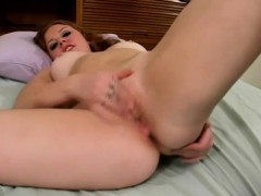busty-beauty-spreads-her-amazing-body-across-the-bed-and-masturbates