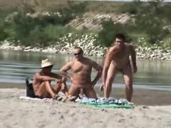 Massive Tittied Blonde Strips Bare In The Seaside