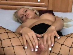 hot-blonde-nicole-is-lying-on-a-bed-wearing-fishnet