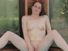 brunette-masturbates-with-a-toy-in-the-pool