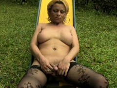 daring-blonde-tbabe-reveals-big-breasts-in-public-playground
