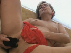 horny-blonde-milf-fills-herself-with-a-toy