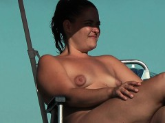 stripped-breasty-honey-widens-legs-at-the-nudist-beach
