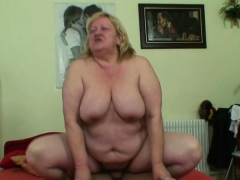 grandma-with-huge-boobs-rides-his-young-cock