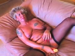 Pierced tattooed mature masturbating cunt