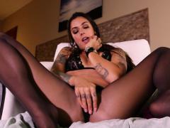 business-woman-pleasures-her-feet-in-her-office