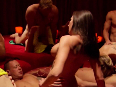 swinger couples strip down as they play