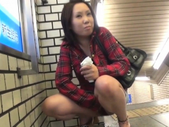 Asian teen urinates