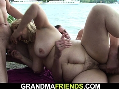 two-buddy-fuck-old-blonde-granny-on-the-beach