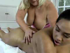 lesbian-gran-masseuse-oils-up-asian-babe