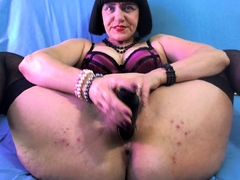 curvy-mature-mom-in-stockings-toying-hairy-pussy