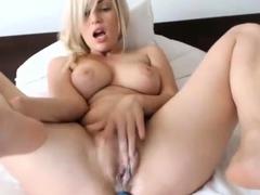 busty-blonde-girl-having-fun-masturbating-on-webcam