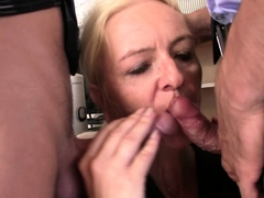 Blonde old woman swallows two dicks for job